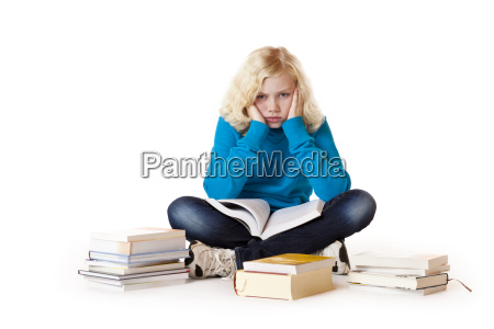 schoolgirl sitting tired and frustrated on