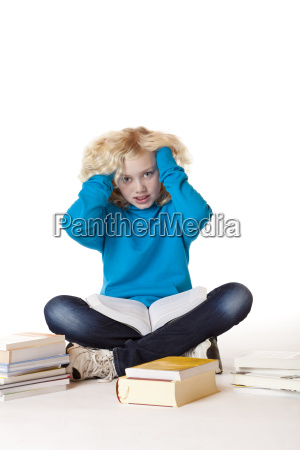 schoolgirl sitting with books on the