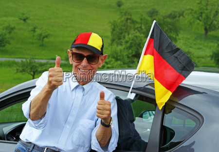 senior soccer fan with germany flag