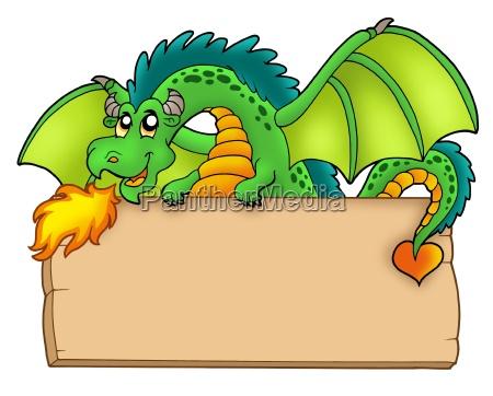 giant green dragon holding board