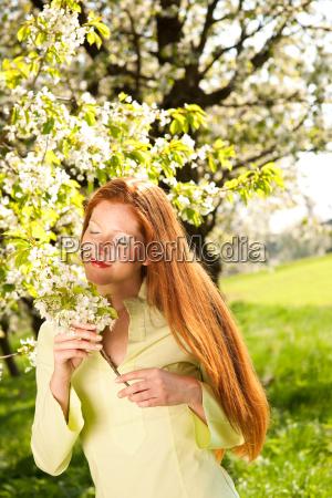 spring woman blossom tree park