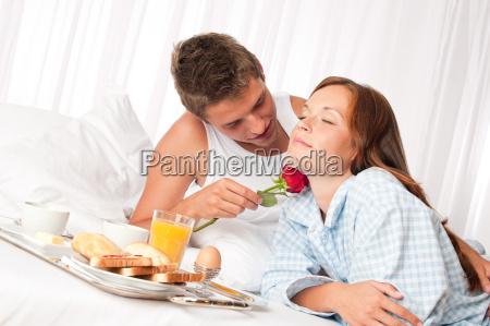 happy man and woman having breakfast