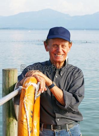 senior on vacation at sea