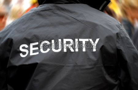 back of a security guard in