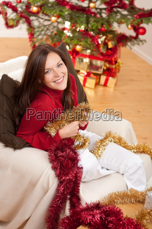 attractive young woman with christmas decoration