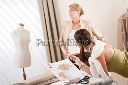 fashion model fitting clothes by professional