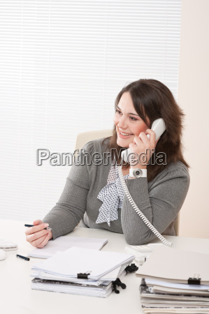 smiling young business woman on phone