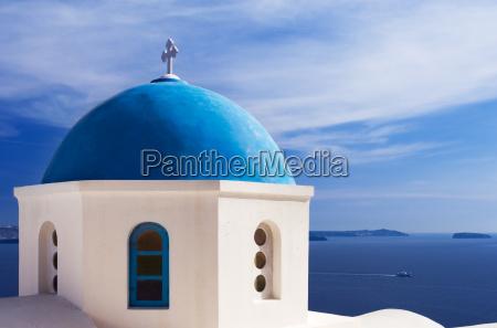 blue church dome in santorini greece