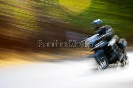 absract of motorbiker zooming mumbai goa