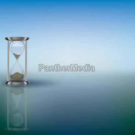 stundenglas auf blauem hintergrund