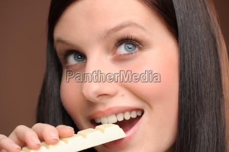 chocolate close up woman bite