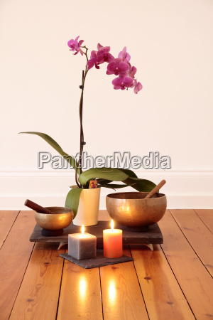 orchid candles and singing bowl