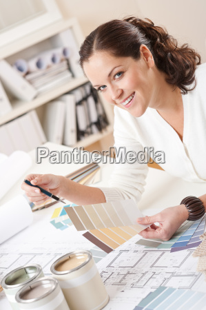 young female interior designer working at