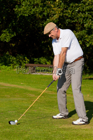 older golfer in summer