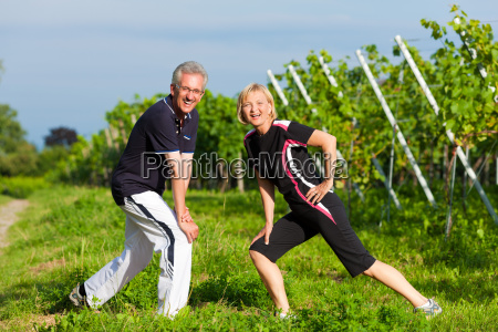 elderly couple do sports in nature