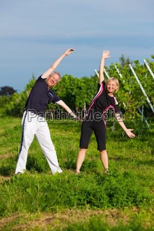 mature couple doing sports in nature