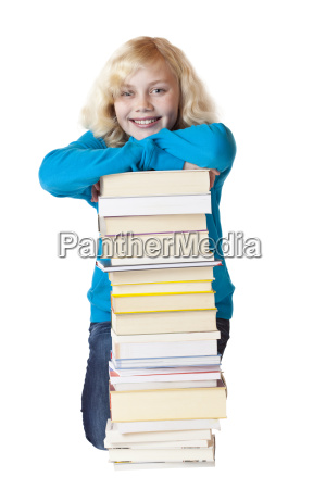young girl leaning on pile of