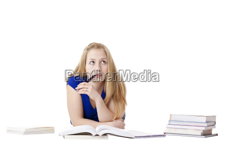 attractive blond woman with books thinks