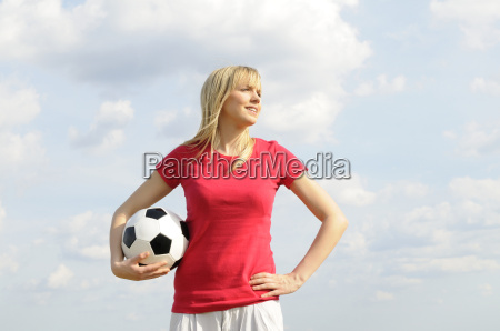young woman with football