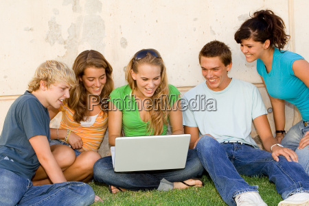 kids with laptop looking at internet