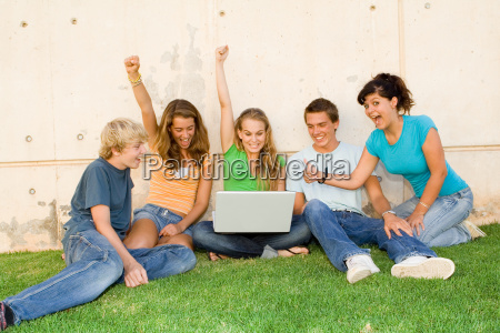 group of teens with laptop hands
