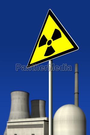 atomkraftwerk hinter einem warnschild fuer radioaktivitaet