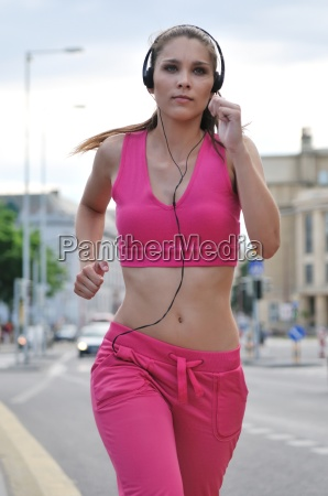 young person listening misic running in