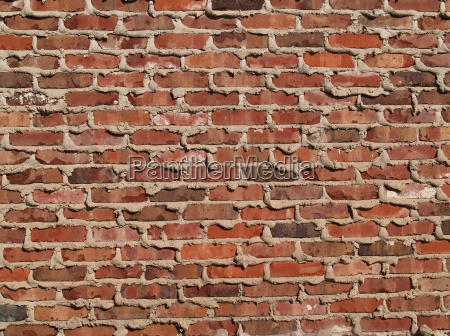 brick wall with mortar oozing from