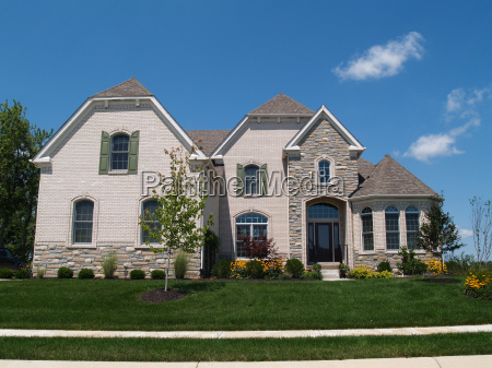 two story white brick and stone