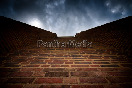 brick wall to dark sky