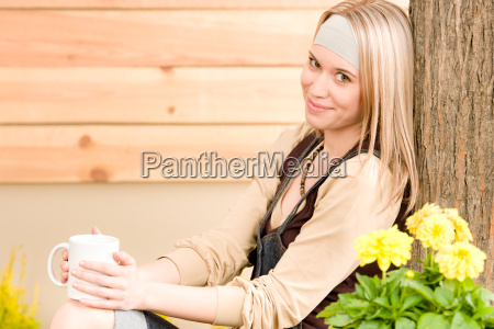 garden woman terrace enjoy cup coffee