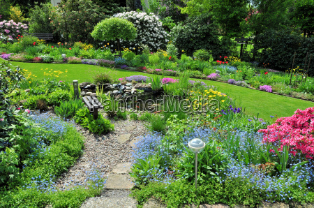 garden with pond and bench