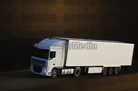 speed yellow semi truck on highway