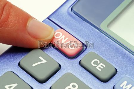 pocket calculator blue close up