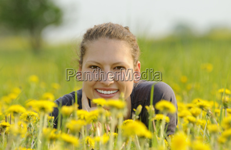 young woman on a flower meadow