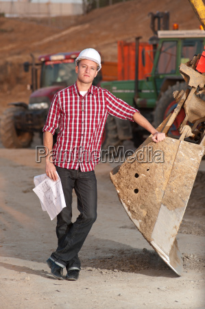 architect working outdoors on a construction