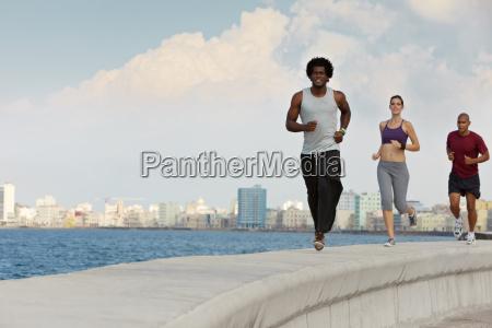 three friends doing sport activities near