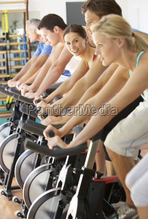 woman cycling in spinning class in