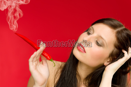 chili pepper portrait young woman smoke