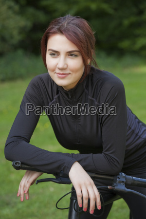 mountain bike girl having break