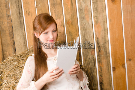 young romantic woman in barn hold