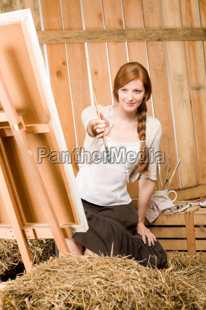 red hair romantic woman in barn