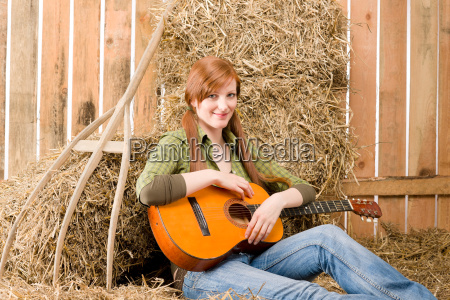 young country woman play guitar in