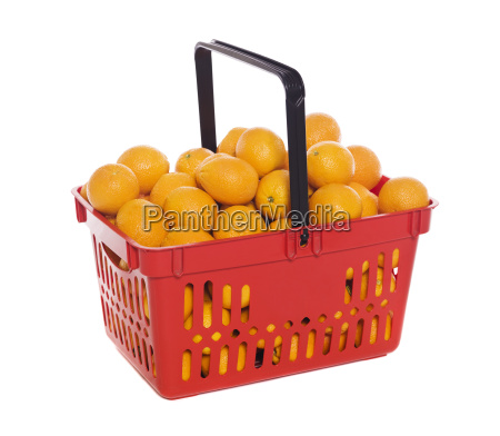 shopping basket with oranges isolated towards
