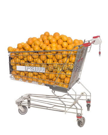 shopping cart with oranges isolated towards