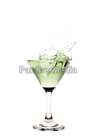 green liquid splashing in a martini