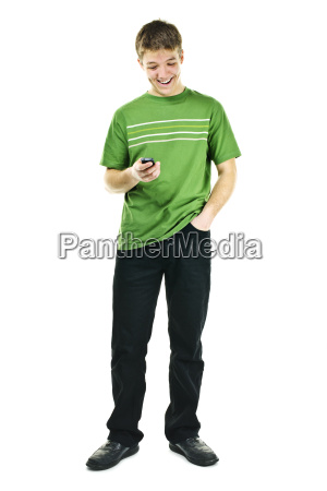 smiling young man holding cell phone