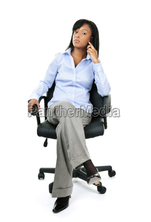 businesswoman on phone sitting in office