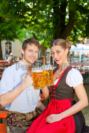 couple with pints of beer in