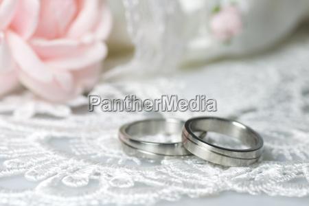 wedding rings on romantic background